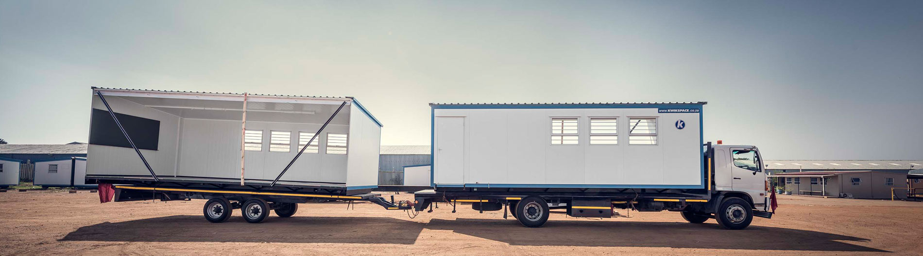 Interlocking panels and interlocking panel systems turns single-wide units into double-wide units easily and quickly. Kwikspace is a manufacturer of prefabricated modular units